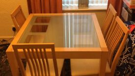 Wood table with four chairs