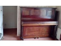 Old iron-frame overstrung piano.
