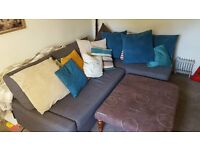 £100- Large blue corner sofa / sofa bed (King size bed) inc cushions (Footstool also for £20)