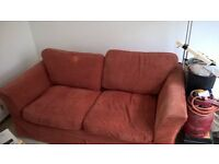 Old distressed but servicable sofa bed. Needs some TLC