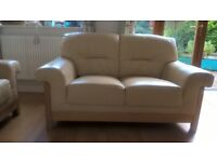 2 cream leather sofas. One 3 seater & one 2 seater. Solid light oak frames. minor damage to leather