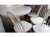 White pedestal table and 4 chairs.