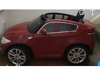 Red BMW X6 kids battery operated ride-on car