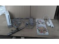 nintendo wii comes with 2 games and everything in the picture