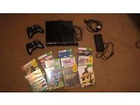 Xbox 360 with 2 controllers, all wires and 11 games.