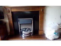 wooden fire surround and coal effect electic fire