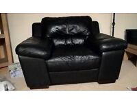 Three seater black leather sofa, arm chair & large storage poof. All very good condition