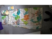 Dinosaur curtains, light shade and wall stickers.