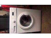 1 year old washing machine, like new £80 & 4 & half foot tall fridgefreezer £60