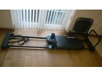 Pilates reformer with rebounder