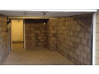 Spacious single garage with additional back compartment for storage.