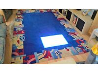 Rug 9' x6' 270cm x 180 cm Bright blue with red yellow and blue patterned edge.