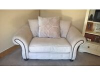large biege 3 seater sofa.cuddle chair and footstool