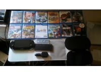 Ps Vita with games,2x memory card case ,1x 16gb memory card , 1x 8gb memory card, more thing