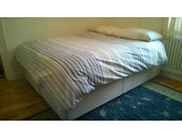 Like-new Dreams double bed with divan drawers + bedding