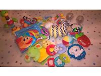 Baby books, rattles, high chair toys & more bundle