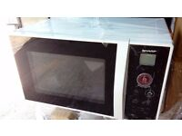 New Sharp R-291KM - Microwave oven - freestanding - 22 litres