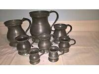 9 vintage pewter jugs