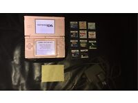 Pink Nintendo DSi lite with charger,11 games and ds cover/wipe