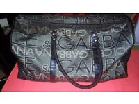 DOLCCI AND GOBBANA OVERNIGHT BAG AND SATCHEL.