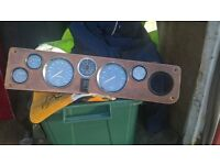 wooden dashboard,mid 60's ford,maybe triump as it has rev counte.