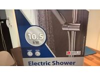Triton 10.5KW shower Unit. Not used. Put it up on the wall but did NOT use it.