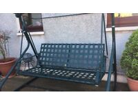 Three seater green metal swing garden bench.