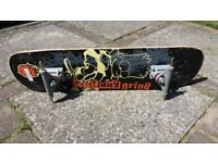 Skateboard deck and trucks only, no wheels.