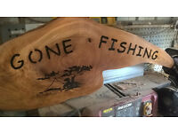gone fishing sign in a fish head shape