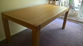 Solid oak dining table with 2 extension leaves & table protector