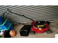 Petrol self-propelled lawn mower