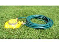 Hoselock garden sprinkler with 8+ metres of hose