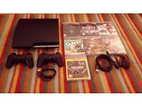 PS3 slim 320gb with 7 games and 2 controllers