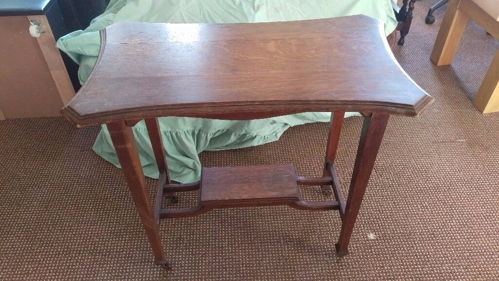 Fancy shaped occasional table with under shelf - metal castors