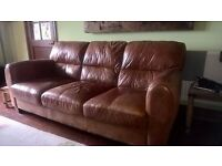 suite of leather armchair, 3 seater settee and 2 x foot stools with storage