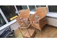Conservatory wicker chairs and glass top table