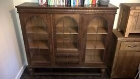 Solid Oak side board with glass doors & draws
