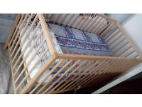 Cot with mattress and 2 anti allergy cot sheets