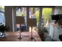 A PAIR OF LAURA ASHLEY GLASS AND BRASS LAMPS WITH JOHN LEWIS IVORY SILK SHADES