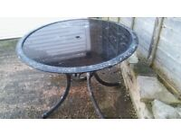 Garden Table with glass surface.