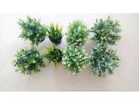 Eight IKEA small artificial plants