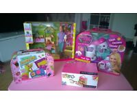 selection of girls toys and wooden dolls house