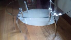 GLASS COFFEE TABLE WITH GLASS SHELF AND CROME LEGS. GOOD WEIGHT