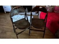 Two antique folding chairs