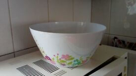 Large cooking bowl with flower designs. In excellent condition
