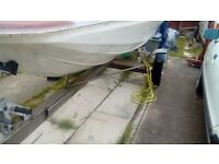 Stainless steel 16-17 ft boat trailer. With free 15 ft speedboat.