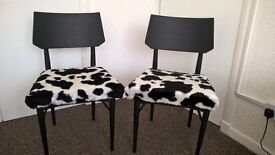 Pair of funky wooden chairs with cow print fabric