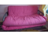 Double Futon Sofa / Bed - Pink with metal frame.