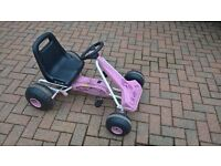 Pink child's pedal go kart, with 2 position adjustable seat