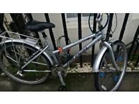 Raleigh spirit nexave hybrid unisex bike. 21 speed. backrack. Needs TLC.